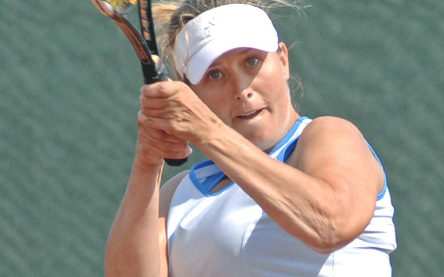 Cheryl Riise makes a two-handed return of a Maya Pardee shot in her 4-6, 4-6 loss to Pardee in the women's  open final at the U.S. Forces Europe tennis championships in Heidelberg, Germany, on Sunday.