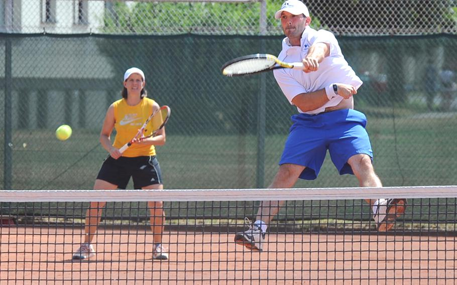Tim Goss makes a leaping return in the mixed finals at the U.S. Forces Europe tennis championships in Heidelberg, Germany, on Suday. Goss teamed up with women's open champion Maya Pardee, left, to defeat Jackie Pitts and Chris Burr 6-2, 7-6 (7-3) in the final.     Michael Abrams/Stars and Stripes