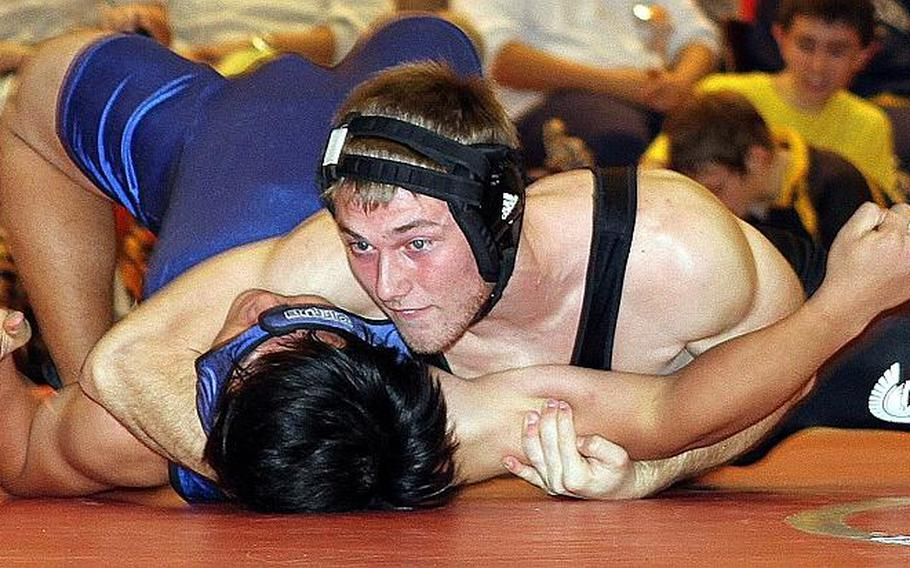 Two-time Far East tournament weight-class gold-medalist Michael Spencer, top, of Zama American.