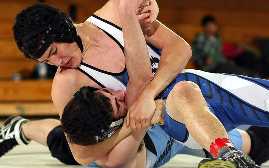 Bryan Hathaway of Seoul American gets Kyle Tarvin of Osan American in a head-in-arm hold during Saturday's 148-pound bout in a DODDS Korea wrestling tri-meet at Seoul American High School, South Korea. Hathaway pinned Tarvin in 3 minutes, 29 seconds and Seoul American won the dual meet, 41-6.