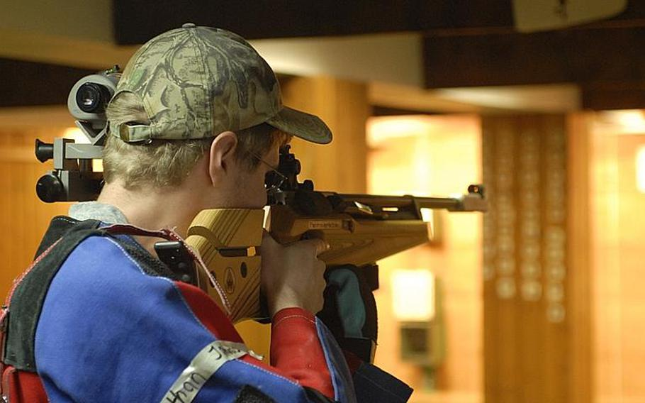 Heidelberg junior Nathan Johnson takes aim at the targets in the standing position at Saturday's high school marksmanship match at Heidelberg High School.
