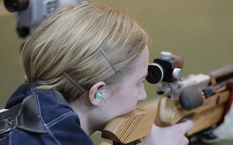 Patch senior Allison Carlson takes aim at the targets at Saturday's high school marksmanship match at Heidelberg High School.  The two-time defending champion Panthers finished first in the three-team compeition for the second straight week.
