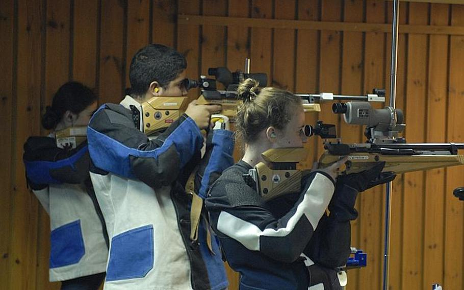 Shooters take aim at the targets in the standing position at Saturday's high school marksmanship match at Heidelberg High School.  Pictured from left are Mannheim sophomore Mykala Paul, Mannheim freshman Carlos Torres and Patch senior Mary McCarthy.