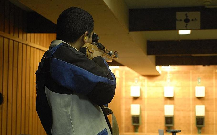 Mannheim freshman Carlos Torres fires at the targets in the standing position at Saturday's high school marksmanship match at Heidelberg High School.  Mannheim finished third to Patch and Heidelberg in the compeitition.