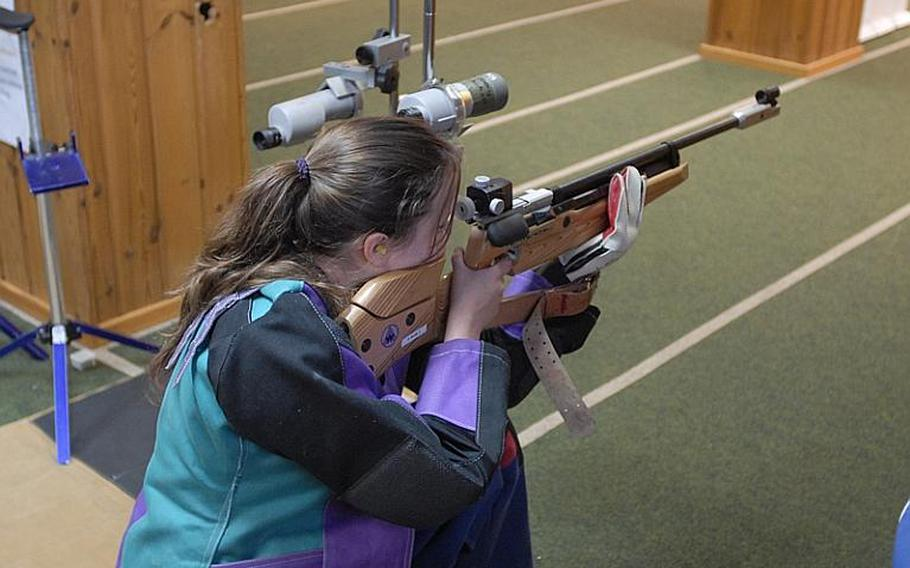Heidelberg senior Katelyn Bronell takes aim at the targets in the standing position at Saturday's high school marksmanship match at Heidelberg High School. She finished fourth in individual scoring.