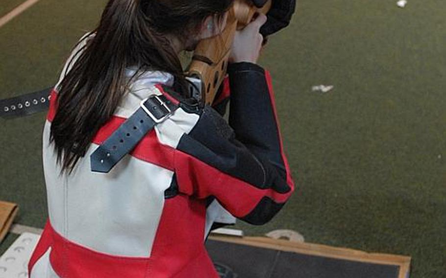 Patch sophomore Jennifer Johnson takes aim at the targets  at Saturday's high school marksmanship match at Heidelberg High School.  Patch, the two-time defending DODDS-Europe champ, won the meet.