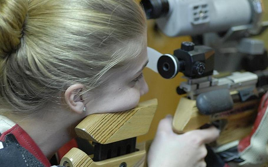 Patch junior Mercedes Romih takes aim at the targets at Saturday's high school marksmanship match at Heidelberg High School.  She finished fifth in individual scoring as two-time defending champ Patch outshot the competition.