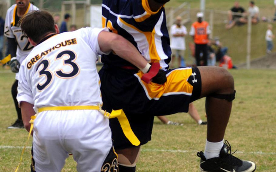 Navy's Donald Dudley has a pass fall just out of his reach as Army's Jonathan Greathouse defends during Saturday's Army-Navy flag football game at Torii Field, Torii Station, Okinawa. Navy broke a six-year losing streak in the 21-year-old series, beating Army, 27-3.