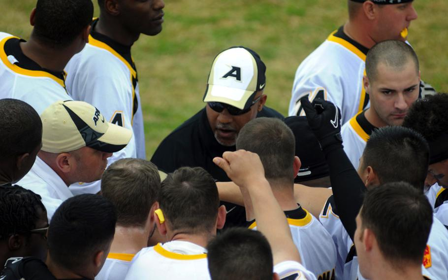 Army coach Lawrence Occomy gathers his charges for a pep talk just before Saturday's Army-Navy flag football game at Torii Field, Torii Station, Okinawa. Navy broke a six-year losing streak in the 21-year-old series, beating Army, 27-3.