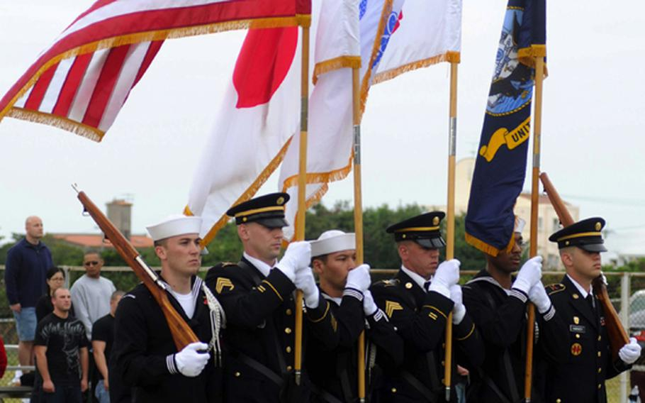 The joint-service color guard parades the colors onto the field before Saturday's Army-Navy flag football game at Torii Field, Torii Station, Okinawa. Navy broke a six-year losing streak in the 21-year-old series, beating Army, 27-3.