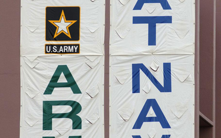 A huge ''Go Army Beat Navy'' sign is draped over the south wall of the Torii Station fitness and sports center during Saturday's Army-Navy flag football game at Torii Field, Torii Station, Okinawa. Navy broke a six-year losing streak in the 21-year-old series, beating Army, 27-3.
