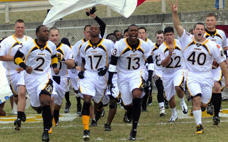 Army charges onto the field prior to Saturday's Army-Navy flag football game at Torii Field, Torii Station, Okinawa. Navy broke a six-year losing streak in the 21-year-old series, beating Army, 27-3.