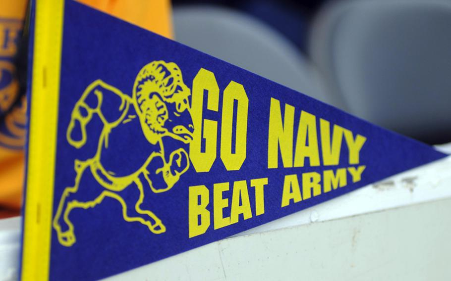 A ''Go Navy, Beat Army'' pennant is on display at Navy's VIP section during Saturday's Army-Navy flag football game at Torii Field, Torii Station, Okinawa. Navy broke a six-year losing streak in the 21-year-old series, beating Army, 27-3.