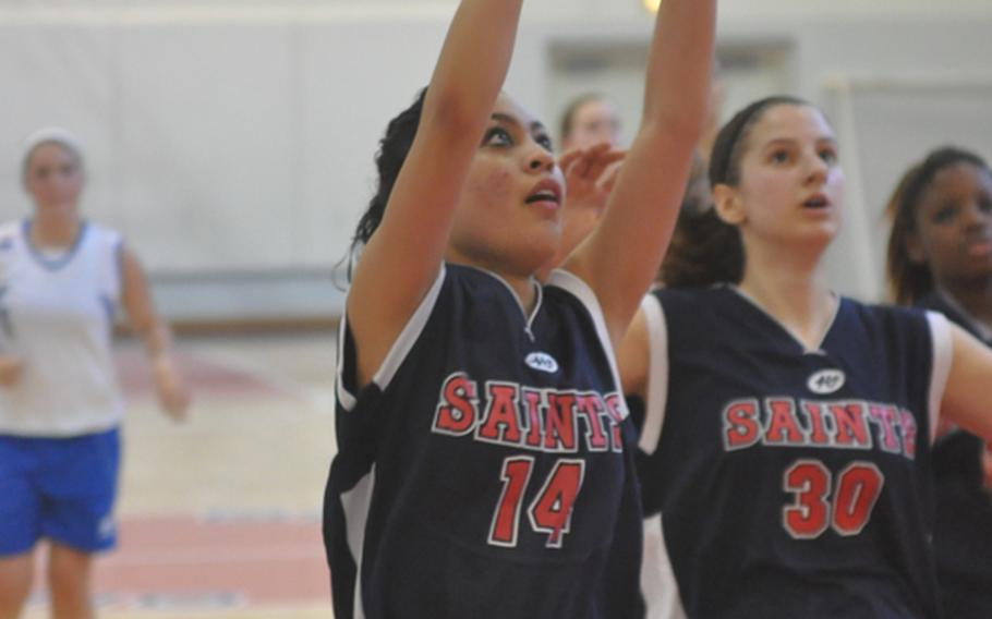 Aviano's Chiara Bustillo puts up a shot Saturday in her team's 51-9 victory over Marymount International, while teammate Katlyn Atchley looks for a potential rebound.