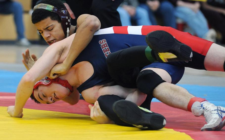Baumholder's Adrian Julien, top, won the 112-pound title at last year's DODDS-Europe wrestling finals by beating Tyler Lloyd of Lakenheath. Both wrestlers will be returning this year, and their teams are expected to challenge for division crowns.