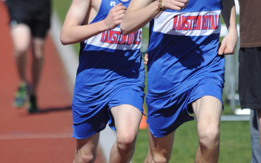 Ramstein's Carl Lewenhaupt, right, leads teammate Jack Scranton into the final lap of the boys 1,500-meter race at Ramstein on Saturday.  Scranton passed Lewenhaupt to win the race in 4 minutes, 25.38 seconds. Lewenhaupt posted a 4:25.84. Complete results from the meet were not available Saturday evening.