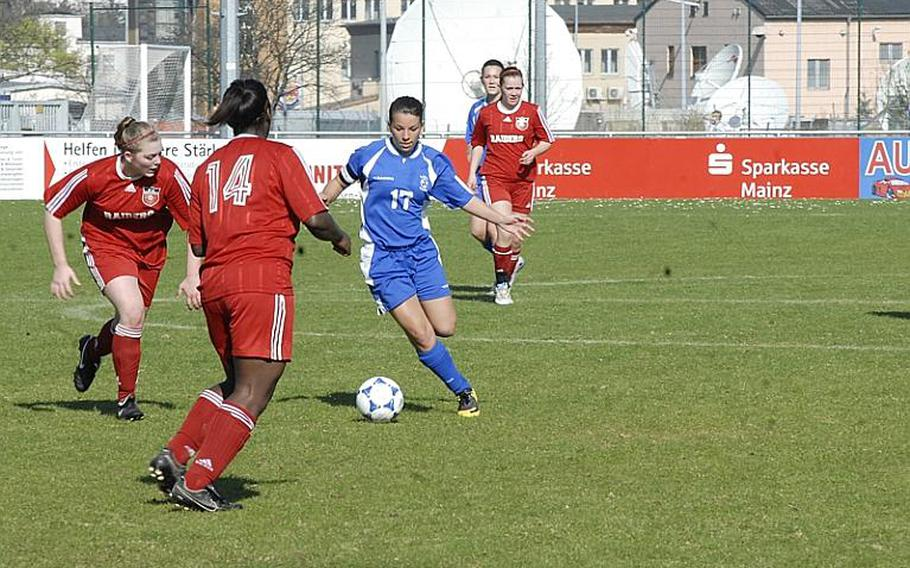 Wiesbaden senior Celina Ponte tries to shake off Kaiserslautern defenders at the Stadion In der Witz in Mainz-Kastel, Germany. Although Ponte scored two goals for the Lady Warriors, Kaiserslautern won the match, 5-3.