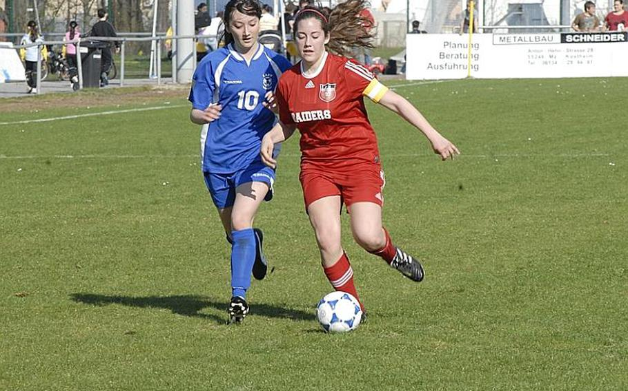 Kaiserslautern senior Olivia McQuail tries to keep the ball ahead of Wiesbaden junior Andrea Arnold during the first half of their game at the Stadion In der Witz in Mainz-Kastel, Germany.  The Lady Raiders went on to win, 5-3, as McQuail scored two goals.