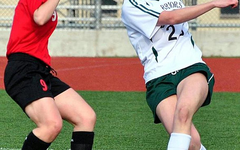 Jennifer Fay, left, of Seoul Foreign and Kristina Bergman of Daegu American battle for the ball during Friday's Korean-American Interscholastic Activities Conference Girls Division I soccer match at Camp Walker, South Korea. The Crusaders handed the Warriors their first regular-season loss, 2-1.