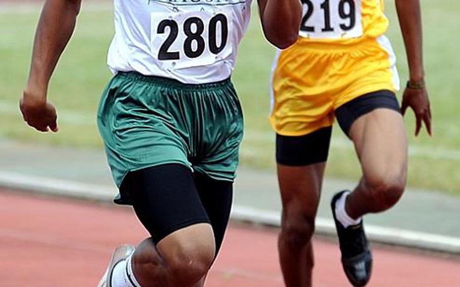 Kubasaki's A.J. Watson leads Kadena's Derrick Taylor in the home stretch of the boys 400-meter final during Saturday's Okinawa Relays at Kubasaki High School, Okinawa. Watson won in 51.55 seconds.