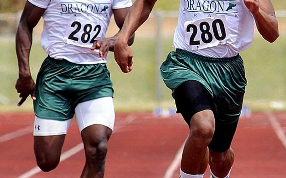 Kubasaki's A.J. Watson, right, leads teammate Jalah Patten through the final yards of the boys 100-meter dash  during Saturday's Okinawa Relays at Kubasaki High School, Okinawa. Watson won the event in 10.27 seconds, .28 better than the 1988 Pacific record set by Tim Gardner of Yokota.