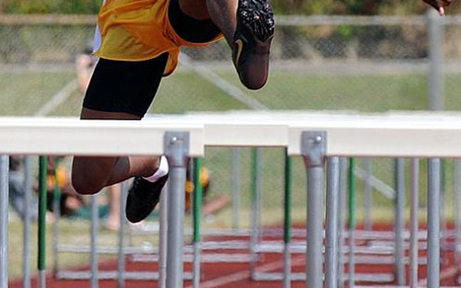 Kadena's Derrick Taylor negotiates the boys 110-meter hurdles during Saturday's Okinawa Relays at Kubasaki High School,  Okinawa. Taylor won in 16.68 seconds.