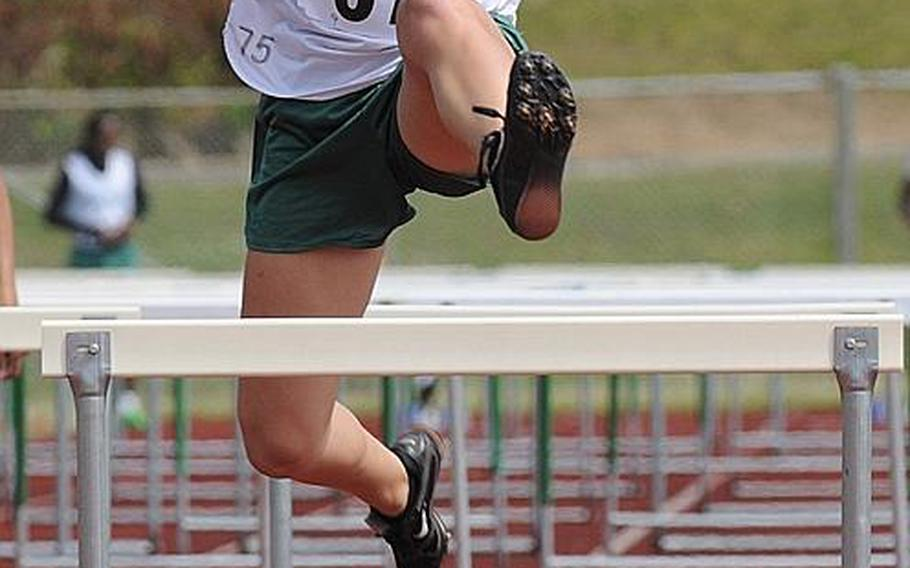 Kubasaki's Micaela Sherman leaps the final hurdle in the girls 100-meter hurdles final during Saturday's Okinawa Relays at Kubasaki High School, Okinawa. Sherman won in 17.34 seconds.