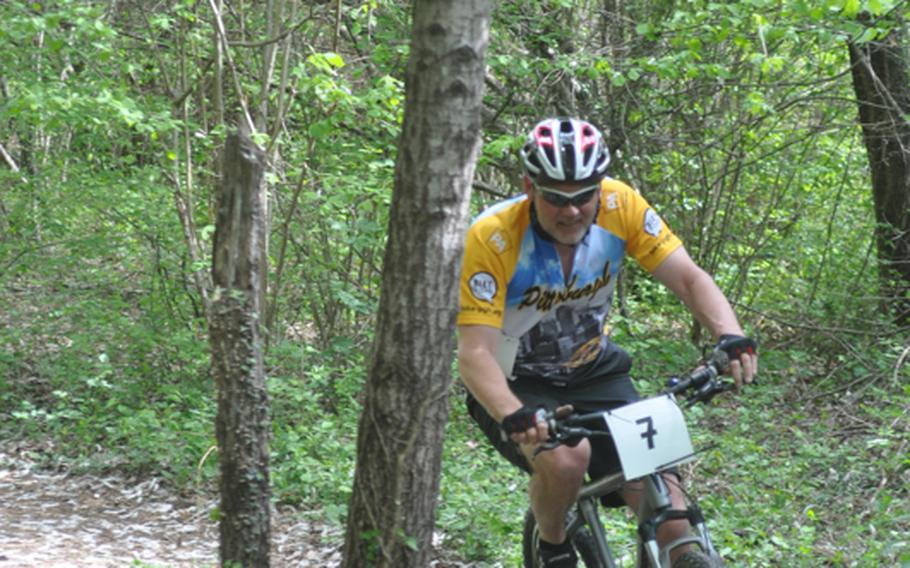 Jeffrey Pannaman of Stuttgart, Germany, passes through the trees Saturday during the first leg of the U.S. Forces in Europe mountain bike series on a course near Aviano Air Base, Italy. Pannaman finished in 1 hour, 47 minutes and 51 seconds -- third overall and first in men's masters (40-older).