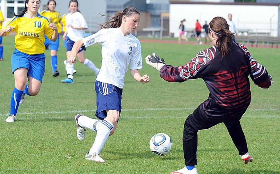 Heidelberg's Melissa Frye goes around Bamberg goalie Heather Smith to score a goal in the Lady Lions' 8-1 win over Bamberg on Friday afternoon. At left is Bamberg's Carrie Bentley.