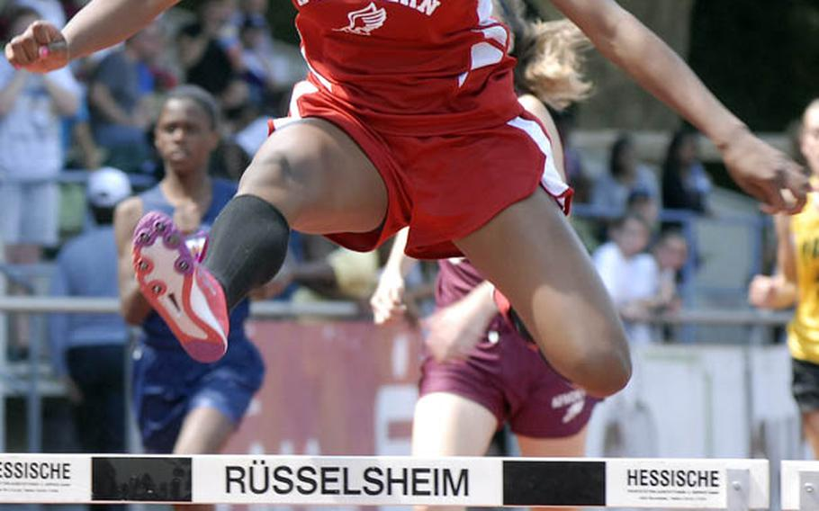 Kaiserslautern sophomore Ashley Santos clears the final hurdle en route to a first-place finish in the girls 300 meter hurdles at the 2011 DODDS-Europe Track and Field Championships in Russelsheim, Germany.   Santos finished with a time of 48.60 seconds.