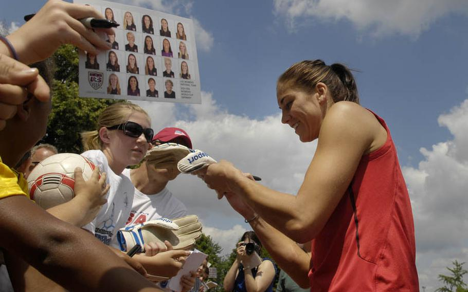 Hope Solo, the U.S. Women's National Team goal keeper, signs autographs after Thursday's practice session held at SG Kirchheim soccer field in Heidelberg, Germany, before the team's second 2011 World Cup game against Colombia. Many local U.S. military members and their families were invited to watch the practice session.