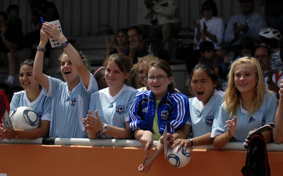 Girls from Heidelberg High School and Middle School show their support for the U.S. Women's National Team at the team's practice Thursday at SG Kirchheim soccer field before the team's second 2011 World Cup game against Colombia.