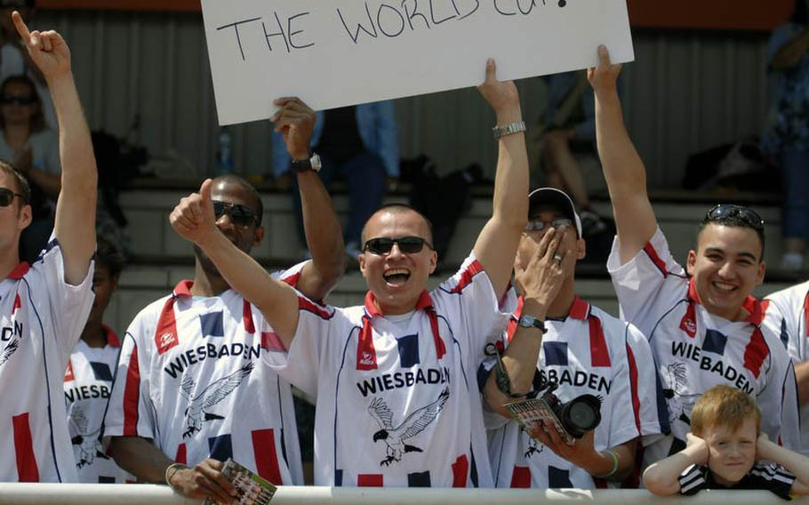 Members of the Wiesbaden soccer club show their support for the U.S. Women's National Team at Thursday's practice session at SG Kirchheim soccer field in Heidelberg, Germany, before the team's second 2011 World Cup game against Colombia.