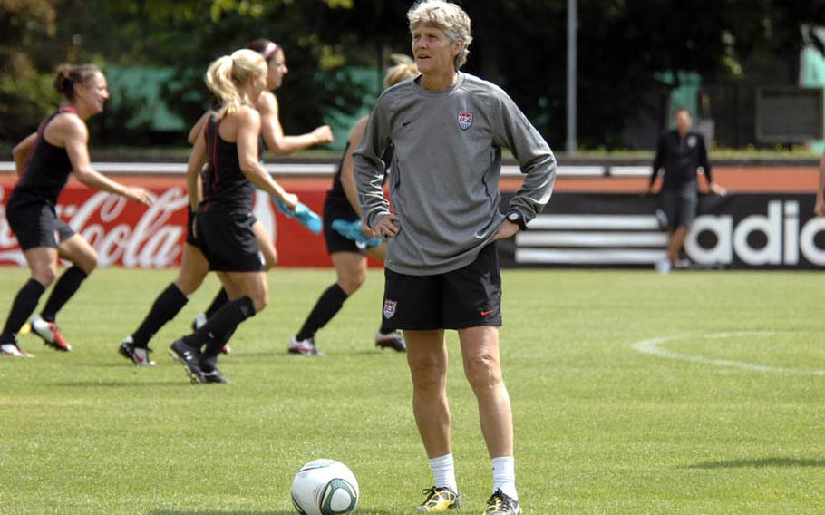 Coach Pia Sundhage watches her team work out during an open practice Thursday in Heidelberg. Hundreds of members of American military communities came out to watch the U.S. national women's soccer team prepare for their second game of the World Cup against Colombia on Saturday in Sinsheim.