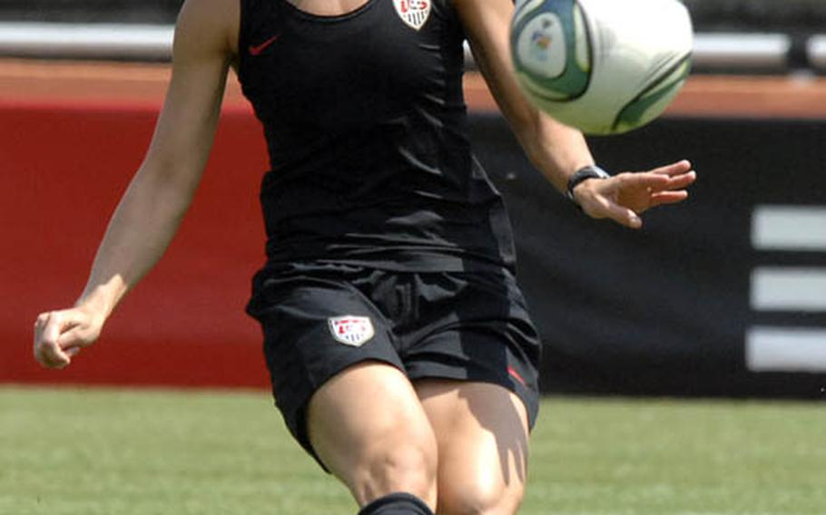 Heather Mitts sends a pass down field during a U.S. women's national soccer team practice Thursday in Heidelberg. Hundreds of members of  American military communities came out to watch the team. The WNT plays their second game of the World Cup against Colombia on Saturday in Sinsheim.