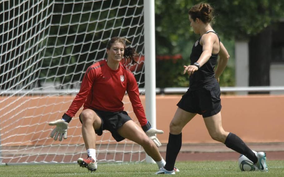 Kelley O'Hara, right, tries to slice the ball past teammate Hope Solo during a U.S. women's national soccer team practice Thursday in Heidelberg. Hundreds of members of  American military communities came out to watch the team. The WNT plays their second game of the World Cup against Colombia on Saturday in Sinsheim.