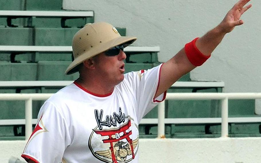 """Marine Corps Air Station Iwakuni coach Keith """"Apples"""" Applegate shouts instructions to his charges during Wednesday's pool-play game against 3rd Marine Division/III Marine Expeditionary Force in the 2011 Marine Corps Far East Regional Softball Tournament at Camp Foster, Okinawa. Division beat Iwakuni 19-8."""