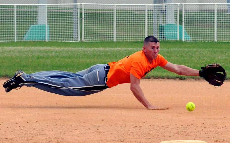 Shortstop and tournament Most Valuable Player Derrick Battle of 3rd Marine Logistics Group dives for a Marine Corps Base Camp S.D. Butler ground ball during Friday's championship-bracket final game in the double-elimination playoffs in the 2011 Marine Corps Far East Regional Softball Tournament at Field 1, Gunners Fitness & Sports Complex, Camp Foster, Okinawa. 3rd MLG won 7-6 in nine innings, then beat Base again 11-9 in Friday' evening's championship game, winning the title for the second straight year.