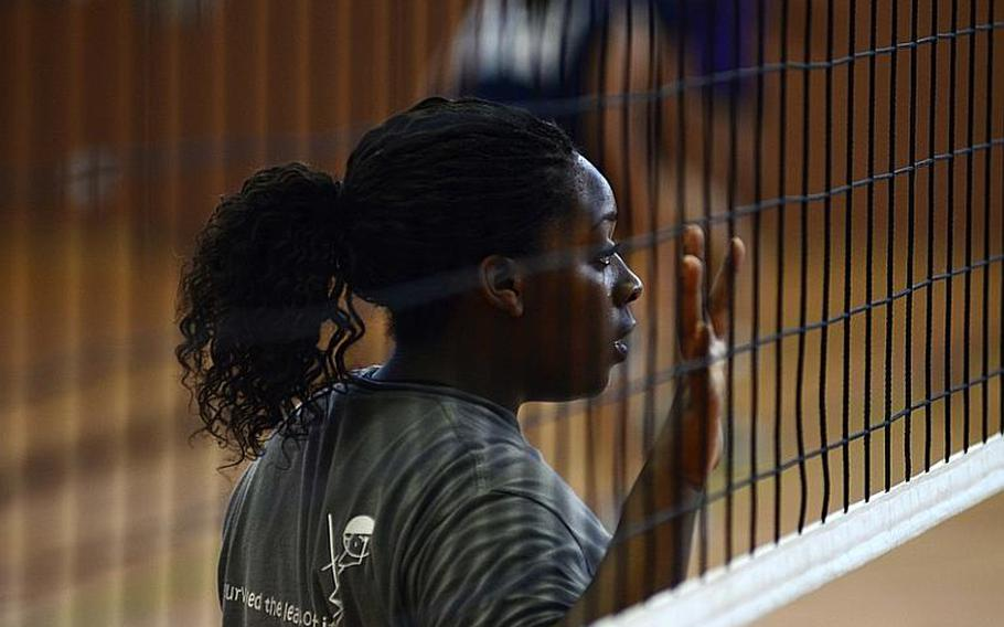 Chelsey Emery, 16, a junior from Bamburg, Germany, practices at the setting position Monday at this year's DODDS-Europe volleyball camp at Vilseck High School .
