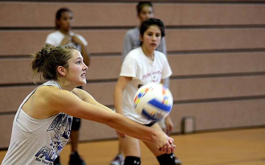 Melissa Menschel, 17, a junior from Bitburg, Germany, bumps a ball Monday during this year's DODDS-Europe volleyball camp at Vilseck High School.