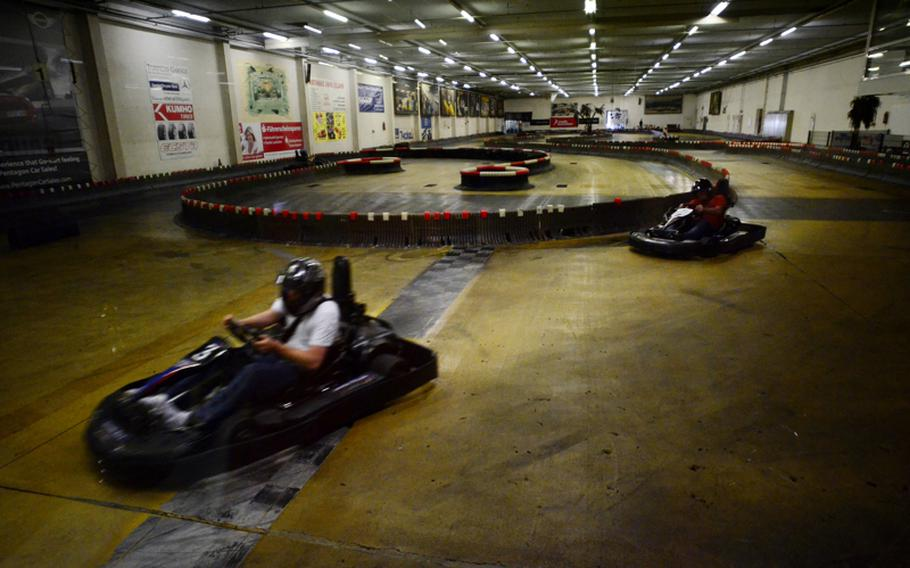 Customers at the Go! Indoor-Kart track near Kaiserslautern, Germany, race at top speeds of 40 miles per hour.