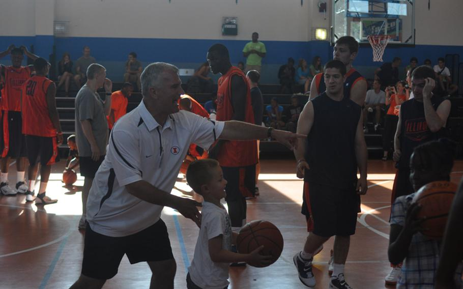 Illinois head coach Bruce Weber directs traffic Wednesday during a clinic at Aviano Air Base, Italy, put on by players and coaches from the universities of Illinois and West Virginia.