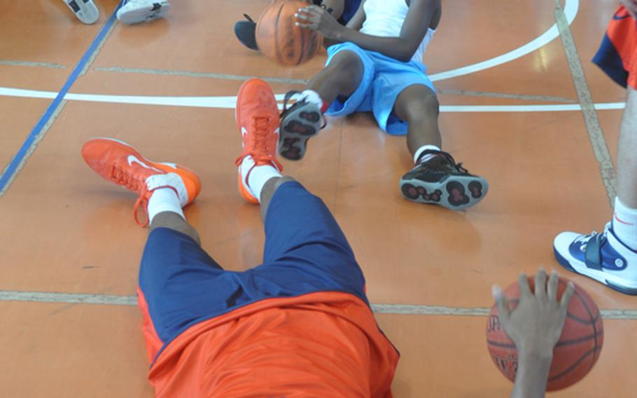 Illinois players and Aviano kids show off their dribbling skills during a clinic Wednesday on base put on by players and coaches from the universities of Illinois and West Virginia.