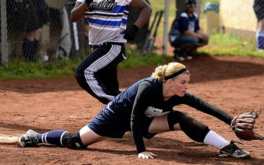 Cary Price, Lakenheath's first baseman, stretches for the ball during the U.S. Forces Europe softball championship at Spangdahlem Air Base.