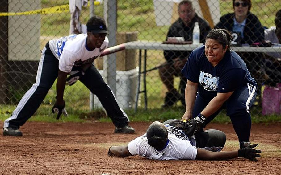 Toria Leon, Lakenheath's catcher, tags Erica Calgero, of Ramstein, out at home in the U.S. Forces Europe women's softball championships Sunday at Spangdahlem Air Base in Germany. Ramstein won the title.