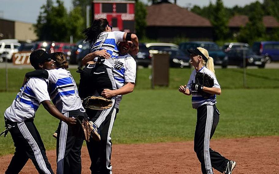 Members of Ramstein Air Base's woman's softball team celebrate after winning the U.S. Forces Europe softball championships at Spangdahlem Air Base, Germany.