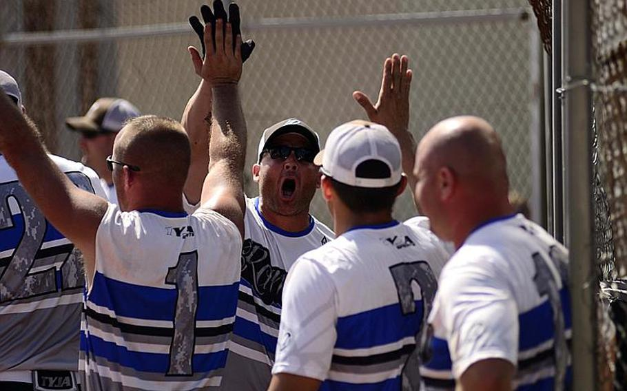 Ramstein's men's softball team celebrates after Mark Noll, center, hit a home run during the U.S. Forces Europe softball championships at Spangdahlem Air Base.