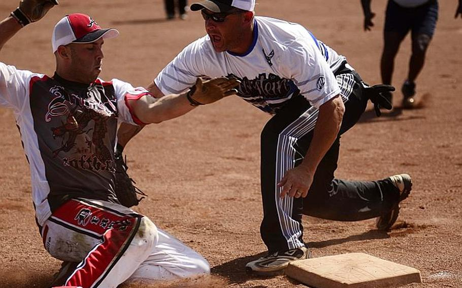 Ramstein's third baseman Mark Noll tags out Aviano's left fielder Jason Paminski in the U.S. Forces Europe softball championships Sunday at Spangdahlem Air Base, Germany. The Rams won the title.