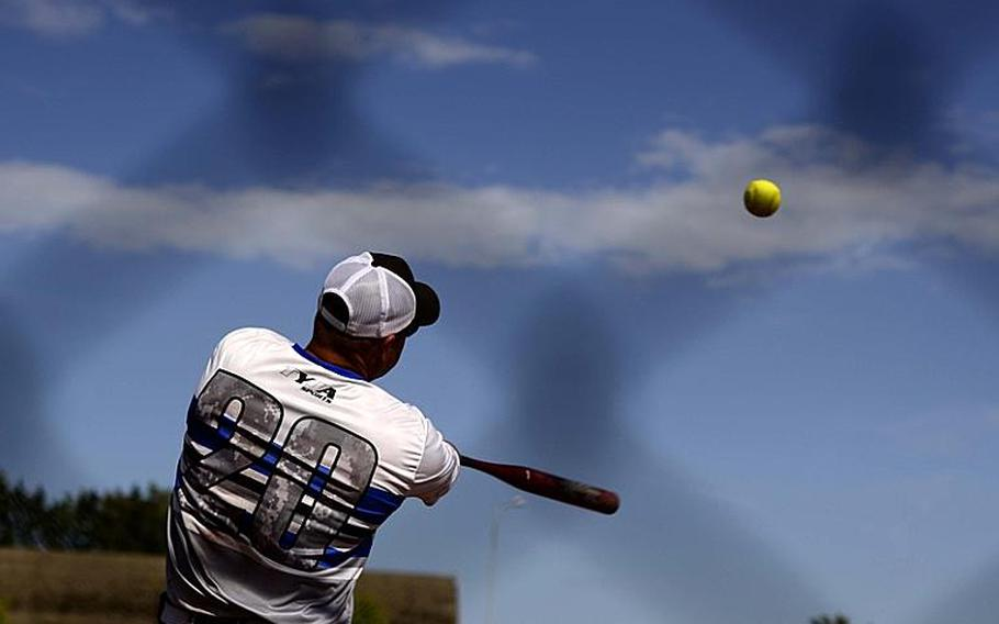 Ramstein third-baseman Mark Noll hits the ball during the U.S. Forces Europe men's softball championship game.