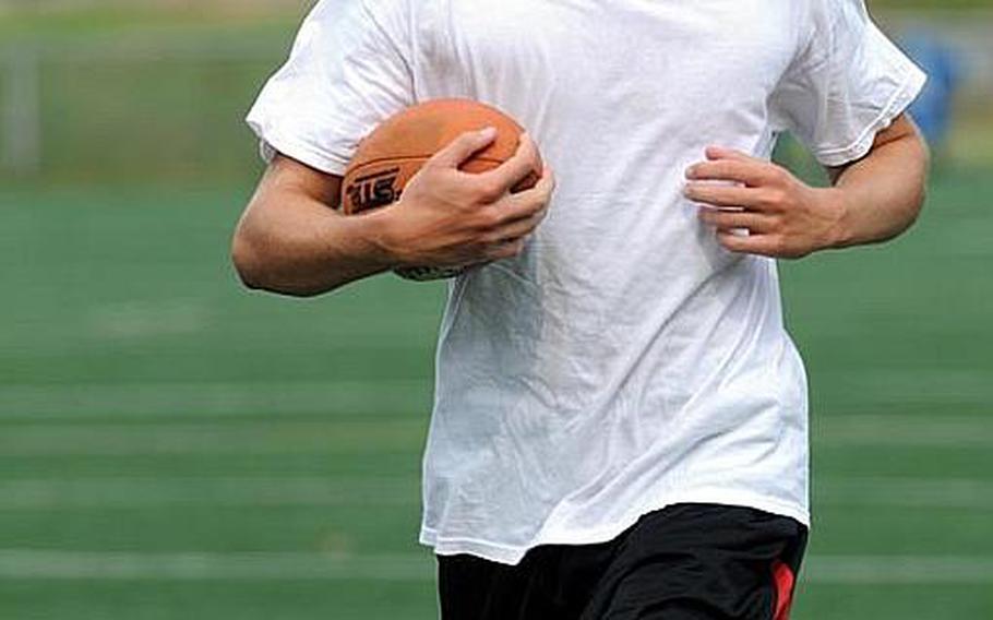 Osan American Cougars senior quarterback Jacob Ives.
